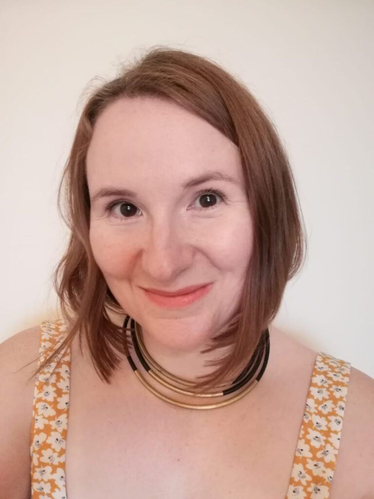 Picture of a celebrant with brown hair and brown eyes smiling at the camera.